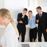 Businesspeople Whispering About Woman