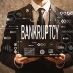 Bankruptcy with businessman holding a tablet computer