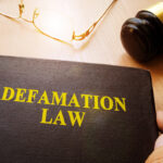 Defamation Law and gavel on a table.